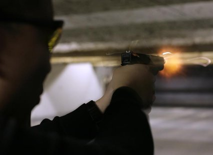 An unidentified man fires his Glock 9 mm pistol at the Maryland Small Arms Range in Upper Marlboro, Maryland, just outside Washington, April
