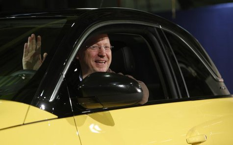 General Motors Vice Chairman, interim President of GM Europe and Chairman of the Opel Supervisory Board Steve Girsky waves as he sits inside