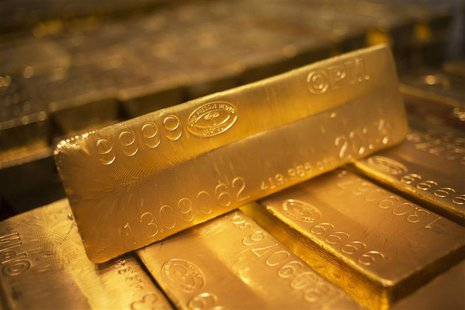 24 karat gold bars are seen at the United States West Point Mint facility in West Point, New York in this June 5, 2013 file photo. REUTERS/S