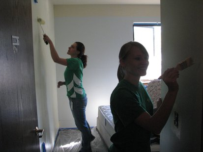 Volunteers painting Family Crisis Center