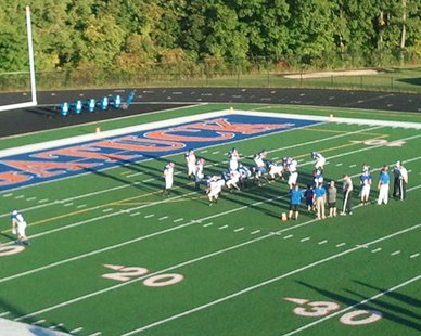 Saugatuck High players prepare prior to a 61-0 win over Bloomingdale at Jarvis Memorial Field on Sept. 27, 2013.