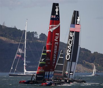 Emirates Team New Zealand (L) sails against Oracle Team USA during Race 19 of the 34th America's Cup yacht sailing race in San Francisco, Ca