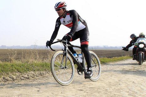 Radioshack rider Fabian Cancellara of Switzerland cycles on a cobble-stoned section of the Paris-Roubaix cycling race during training in Hav
