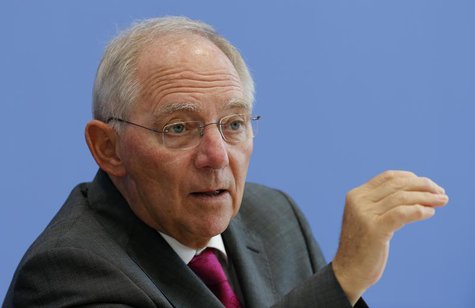German Finance Minister Wolfgang Schaeuble gestures as he addresses a news conference to presents 2014 federal budget bill in Berlin June 26