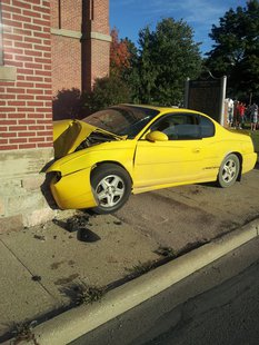 Car crashes into the Marshall Street entrance to the Coldwater First Presbyterian Church, Friday, September 27, 2013.