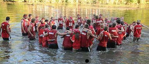 Members of the Class of 2016 celebrate in the Macatawa River after taking the 2013 Hope College Pull tug-of-war on Sept. 28, 2013. (photo courtesy Hope College)