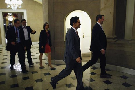 U.S. House Majority Leader Eric Cantor (R-VA) (C) walks into the offices of Speaker John Boehner (R-OH) (not pictured) during a rare late-ni