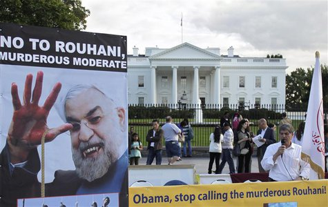 Iranian Americans protest against a conversation between U.S. President Barack Obama and new Iranian President Hassan Rouhani, outside the W