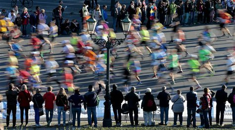 Spectators watch as runners compete in the 40th Berlin marathon, September 29, 2013. REUTERS/Tobias Schwarz