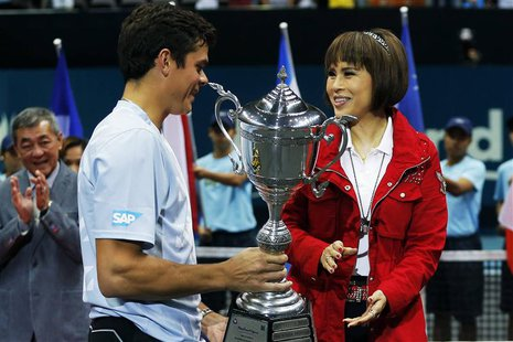 Thai Princess Ubolratana Rajakanya (R) presents the winner's trophy to Milos Raonic of Canada after the men's singles final match at the Tha
