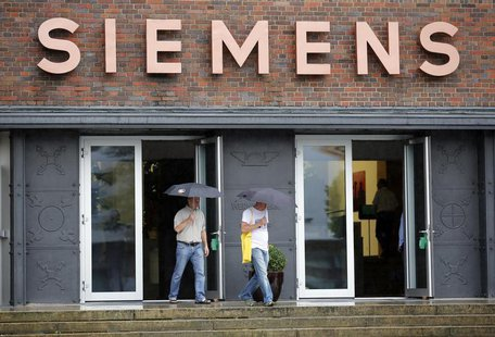 People walk out of an office building of Siemens AG in Berlin July 29, 2013. REUTERS/Fabrizio Bensch