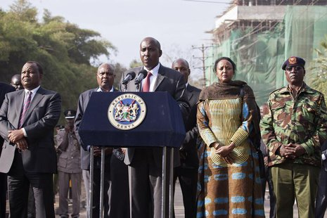 Kenya's Interior Minister Joseph ole Lenku (C), flanked other government officials, speaks during a news conference near the Westgate shoppi