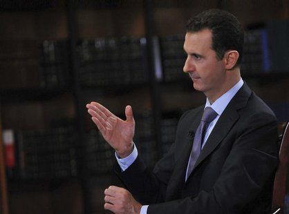 Syria's President Bashar al-Assad speaks during an interview with Italian television station RaiNews24 in Damascus in this handout photograp