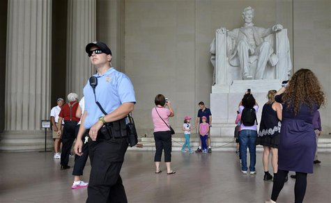 A US Parks Policeman walks among tourists flocking to the Lincoln Memorial, in Washington, September 29, 2013, as a possible government shut