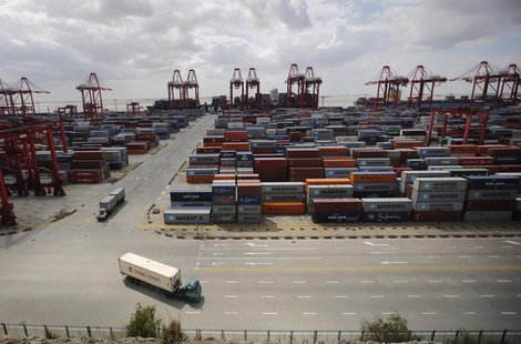 Container trucks drive past the container area at the Yangshan Deep Water Port, part of the newly announced Shanghai Free Trade Zone, south
