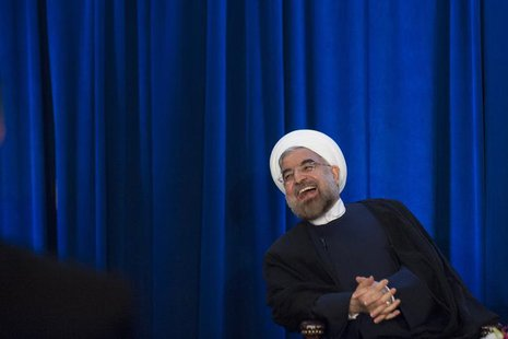 Iran's President Hassan Rohani laughs as he speaks during an event hosted by the Council on Foreign Relations and the Asia Society in New Yo