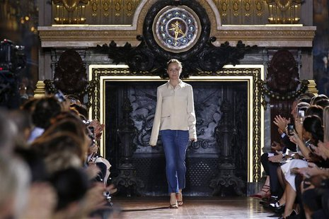 British designer Stella McCartney appears at the end of her Spring/Summer 2014 women's ready-to-wear fashion show during Paris fashion week