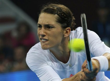 Andrea Petkovic of Germany hits a return against Victoria Azarenka of Belarus at the China Open tennis tournament in Beijing September 30, 2