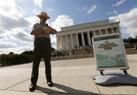 U.S. National Park Ranger Mark Ragan checks his watch while on duty in front of the Lincoln Memorial in Washington September 30, 2013. REUTE