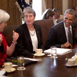 U.S. President Barack Obama speaks with Health and Human Services Secretary Kathleen Sebelius (L) during a cabinet meeting in the West Wing