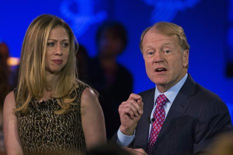 John Chambers, chairman and CEO of Cisco speaks in front of Chelsea Clinton at the Clinton Global Initiative (CGI) in New York September 25,