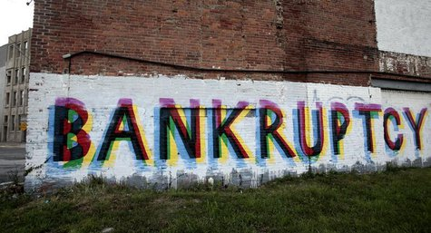 The word 'Bankruptcy' is seen painted on the side of a vacant building by street artists as a statement on the financial affairs of the city