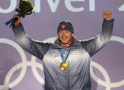 Gold medallist Bode Miller of the U.S. celebrates during the medals ceremony for the men's super combined alpine skiing event during the Van