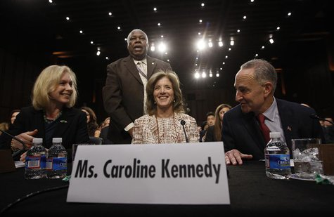 Caroline Kennedy (C), daughter of former U.S. President John F. Kennedy, prepares to testify at her U.S. Senate Foreign Relations Committee