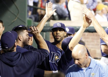 Sep 30, 2013; Arlington, TX, USA; Tampa Bay Rays starting pitcher David Price (middle) is welcomed back to the dugout after retiring the Tex