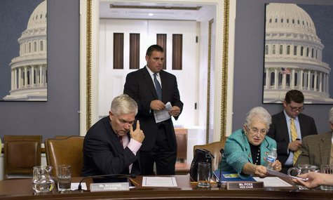 Chairman of the House Rules Committee, Representative Pete Session (L) (R-TX) and Representative Virginia Foxx (R-NC) sit after a late-night