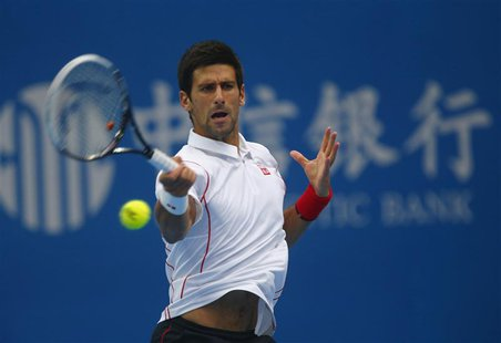 Serbia's Novak Djokovic returns a shot during his match against Lukas Rosol of the Czech Republic at the China Open tennis tournament in Bei