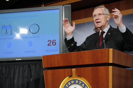 U.S. Senate Majority Leader Harry Reid (D-NV) stands next to a countdown clock as he speaks at a news conference at the U.S. Capitol in Wash