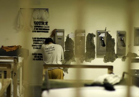 An inmate makes a phone call from his cell at the Orange County jail in Santa Ana, California, May 24, 2011. REUTERS/Lucy Nicholson
