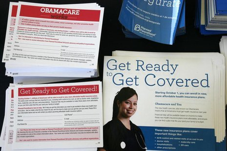 Information cards are stacked on a table during an Affordable Care Act outreach event for the Latino community in Los Angeles, California Se