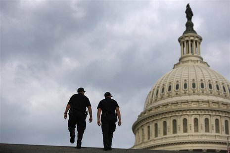 U.S. Capitol Police return to patrol after a brief meeting to discuss how to handle tourists turned away from the shuttered visitor's center