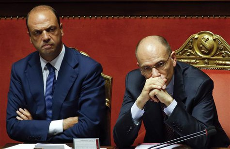 Italy's Prime Minister Enrico Letta (R) looks on next to Interior Minister Angelino Alfano during a vote session at the Senate in Rome in th