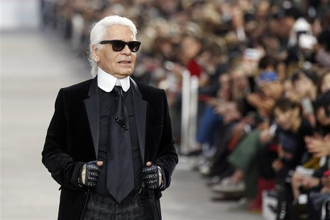 German designer Karl Lagerfeld appears at the end of his Spring/Summer 2014 women's ready-to-wear fashion show for French fashion house Chan