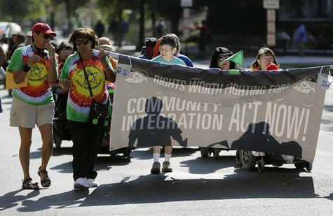 Members of ADAPT, a grassroots disability rights group that supports Obamacare, march in Washington during the U.S. government shutdown Octo