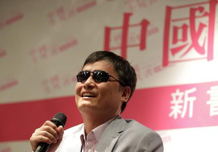 "Chinese dissident Chen Guangcheng attends the book release event for ""China, the Book of Living and Dying"" in Taipei June 27, 2013. REUTERS/"