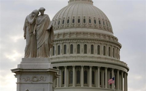 The U.S. Capitol dome is seen behind a statue on Capitol Hill in Washington after the U.S. government shutdown, October 1, 2013. REUTERS/Lar