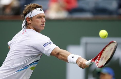 David Nalbandian of Argentina returns a shot against Marcel Granollers of Spain during their match at the BNP Paribas Open ATP tennis tourna