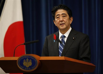 Japan's Prime Minister Shinzo Abe attends a news conference to announce a raise in the sales tax rate at his official residence in Tokyo Oct