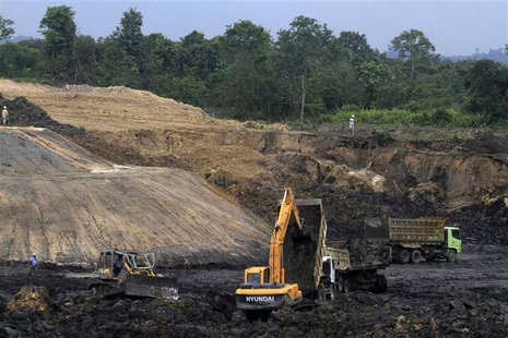 Trucks and machinery are pictured at a PT Exploitasi Energi Indonesia Tbk coal mine at Palaran district in Samarinda, Indonesia east Kaliman