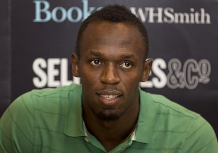 "Jamaican athlete Usain Bolt poses for photographers as he signs copies of his autobiography, ""Faster than Lightning,"" at Selfridges in centr"