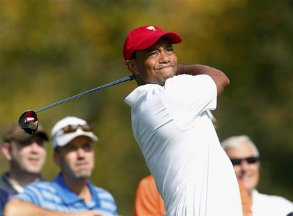 U.S. team member Tiger Woods hits off the third tee during the first practice round for the 2013 Presidents Cup golf tournament at Muirfield