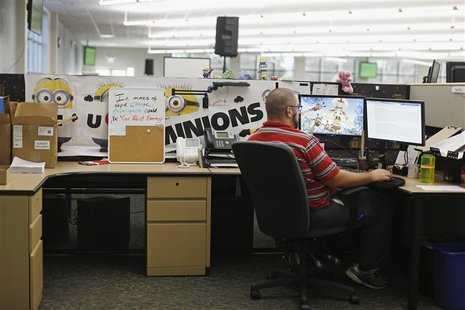 A customer service agent at Covered California's Concord call center works on his computer during the opening day of enrollment of the Patie