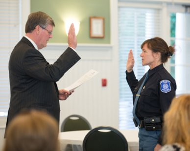 Grand Valley State Public Safety Director Renee Freeman (R) is sworn into office by school president Thomas Haas during ceremonies at the Alumni House in Allendale, MI on Sept. 30, 2013. (photo courtesy Grand Valley State University)