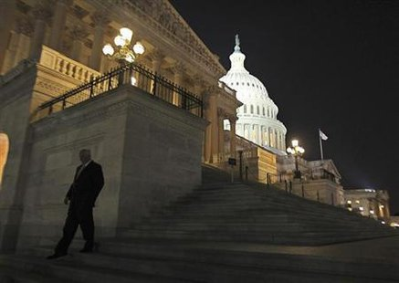 A member of the U.S. House of Representatives walks down the steps from the House Chamber as he exits the U.S. Capitol after the Republican-led House again voted to link funding for the U.S. government to include a delay of ''Obamacare'' in Washington, September 30, 2013. Credit: Reuters/Jim Bourg