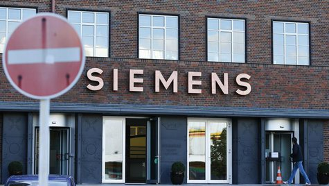 A man enters the office building of Siemens AG in Berlin September 30, 2013. REUTERS/Tobias Schwarz