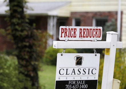 "A ""Price Reduced"" sign is displayed on a home for sale in northern Virginia suburb of Vienna, outside Washington, October 27, 2010. REUTERS/"